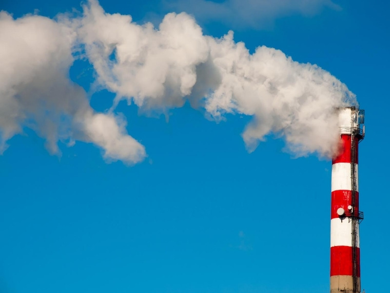 How can a factory reduce its carbon emissions?